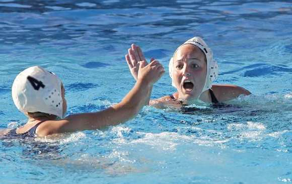 Newport Harbor High's Avery Peterson, right, comes over to high-five Carly Christian after Christian's goal in the second half against Laguna Beach during a quarterfinal game of the CIF Southern Section Division 1 playoffs Saturday.