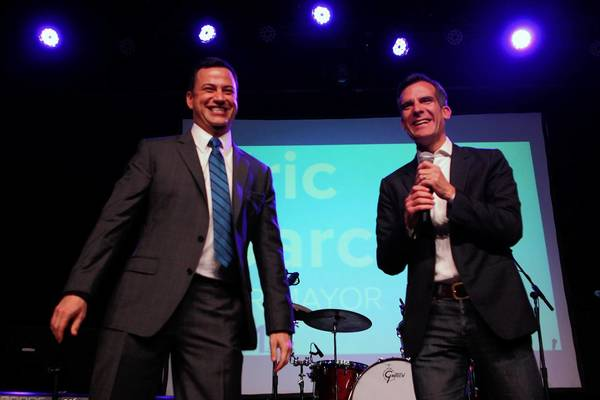 Comedian Jimmy Kimmel, left, was among the celebrities at a recent fundraiser for mayoral candidate Eric Garcetti at the Fonda Theatre in Hollywood. The entertainment industry is turning its attention to City Hall politics like never before, veterans say.
