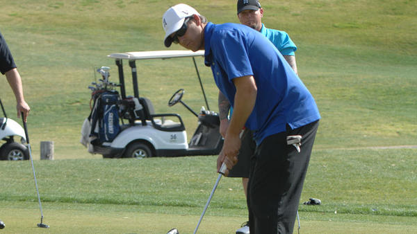 Russell Allen putts the ball at the Imperial Valley Quarterback Club Golf Tournament at Del Rio Golf Resort on Saturday.