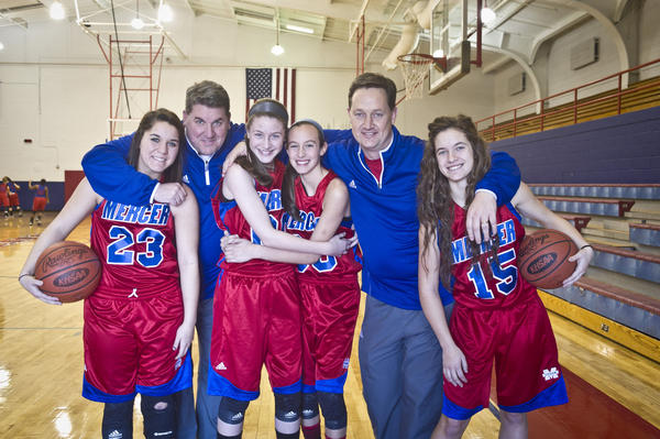 Four players and two coaches in the Mercer County girls basketball program share a familial bond. Sophomore guard Catheryne Claunch (23) is the daughter of assistant coach Todd Claunch, back left. Head coach Chris Souder, back right, is Todd Claunch's brother-in-law and the father of senior guard Carli Souder (15). In the center are seventh-graders Emmy Souder, Chris Souder's niece, and Seygan Robins, Todd Claunch's niece.