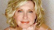Olivia Newton-John said she's always loved singing. She was in her first singing group by the tender age of 15.