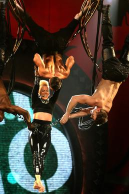 Pink is hooked to bungee cords as she dangles from the Staples Center rafters during her performance Saturday night.