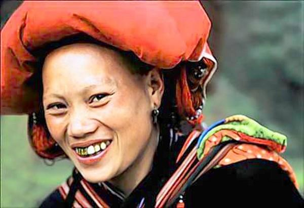 Red Zao women in Vietnam typically shave their eyebrows and wear spectacular red headdresses. This was taken northwest of Hanoi near the Chinese border.