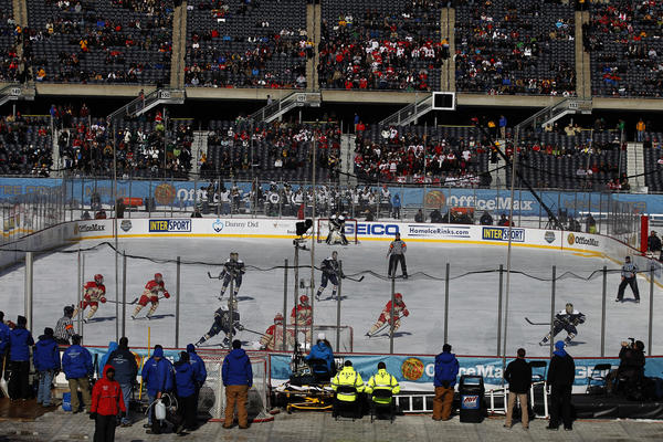 Notre Dame (dark jerseys) and Miami play in the first period of the OfficeMax Hockey City Classic played at Soldier Field in Chicago on Sunday.