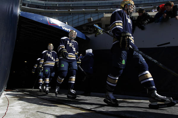 Notre Dame players walk out of the tunnel to play a game against Miami at the OfficeMax Hockey City Classic played at Soldier Field in Chicago on Sunday.