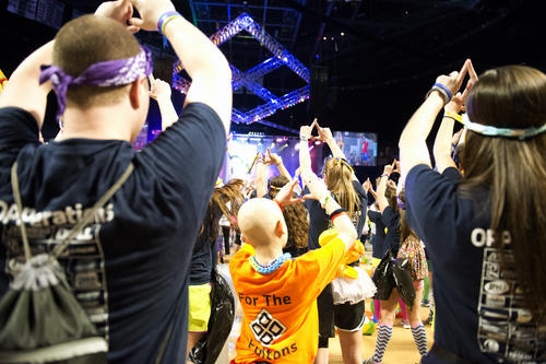 Nick Fulton, 10, of Elliotsburg dances with members of the operations committee at the Bryce Jordan Center Saturday, February 16, 2013.