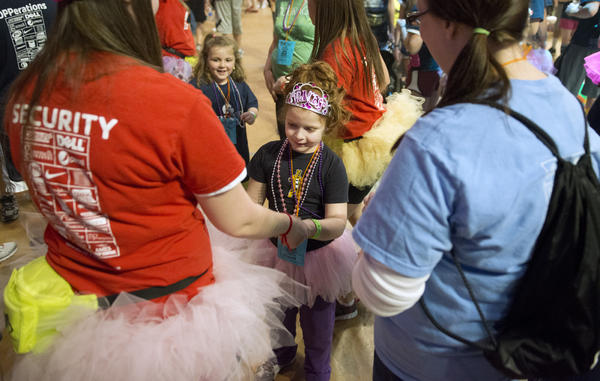 Student Ellen Fagan dances with Isabella Caputo, 7, and her aunt Jillian Jezuit at the Bryce Jordan Center Saturday, February 16, 2013.