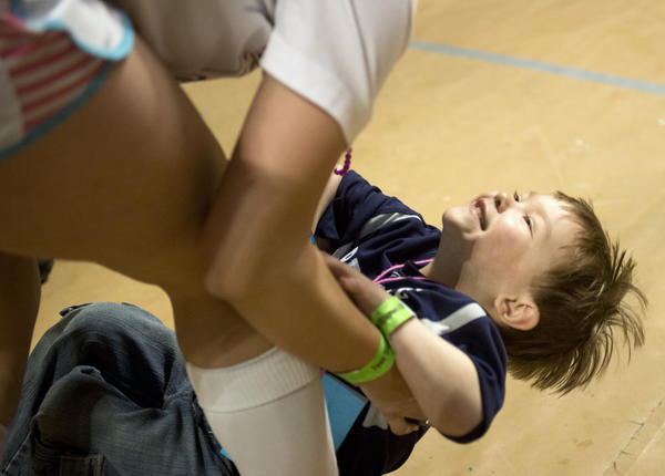 Austin Lightner, 5, of Carlisle Pa. plays with a dancer on the THON dancefloor at the Bryce Jordan Center Saturday, February 16, 2013. Austin was diagnosed with acute lymphoblastic leukemia.