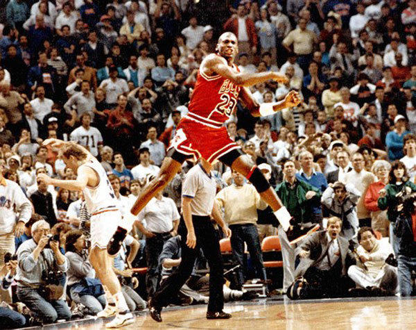 "Michael Jordan celebrates ""The Shot"" against the Cleveland Cavaliers and Craig Ehlo (throwing his arm up in disgust on the left side) on May 7, 1989."