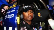 Antron Brown, drag racing's reigning top-fuel champion, walked away from a fiery crash Sunday during the NHRA Winternationals in Pomona.