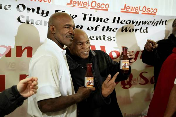 "Boxing legends Evander Holyfield (left) and Mike Tyson (right) pose for photos with the ""Real Deal"" BBQ sauce Holyfield promoted at Jewel at 1655 E. 95th Street Feb. 16, 2013."