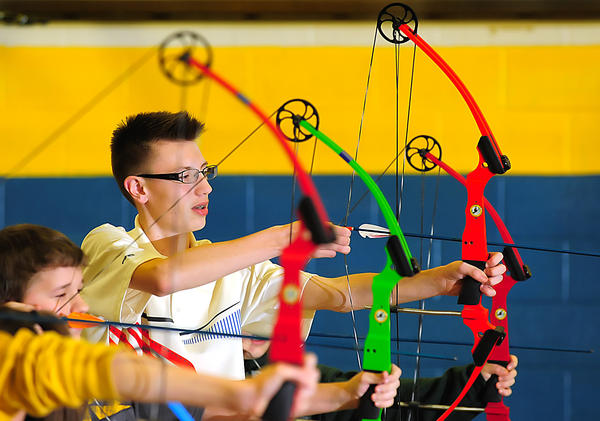 A Clear Spring Middle School archer draws his bow Wednesday during practice in the school gymnasium. The team is preparing for a state tournament.