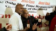 "Chicago once again played host to a <strong>Mike Tyson</strong><strong>-Evander Holyfield</strong> reunion Saturday, just like it did when the two former boxing rivals appeared on ""The Oprah Winfrey Show"" in 2009. But rather than reunite in front of a live studio audience, they smiled and hugged at the Jewel-Osco at 1655 E. 95th St."