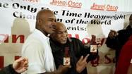 Mike Tyson, Evander Holyfield reunite in Chicago supermarket