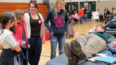 North Star High School student council president Hali Livingston (fourth from left) and classmate and student council historian Alexandria McCartney are shown with blood donor Christopher Evans, the U.S. History and P.O.D. teacher at the high school. Also pictured are several North Star Central elementary student council members. The student councils from both schools assisted with the recent blood drive at the high school.