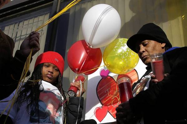 Shapara Hicks, left, and Takala Welch, right, daughter and stepmother of Latorya McGraw, one of the 21 people killed in a stampede 10 years ago at E2 nightclub, pray outside the former nightclub during a ceremony marking the anniversary.