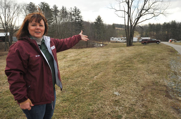 Catherine Webb, whose parents own the farm, gestures toward the patch of field next to the farmhouse driveway off Yeoho Road where her family plans to build a barn with a roadside stand. After a legal battle that dragged on for almost 7 years, the Smith family, who have operated Springfield Farm for 300 years, recently won approval for the free-standing structure. The sale of fresh eggs is about 70 percent of their business, but they also sell chicken. beef, pork, lamb and turkeys.