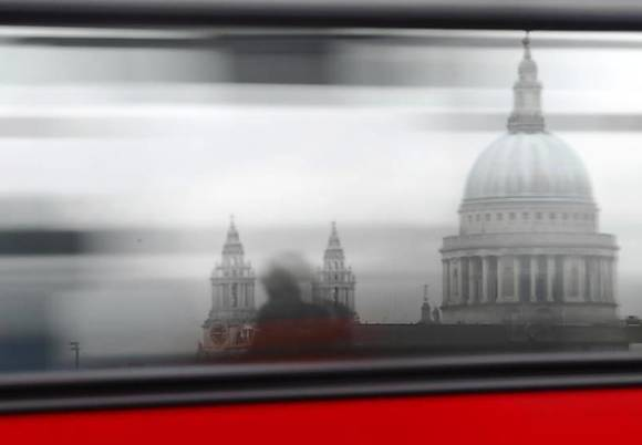 A bus passes St Paul's Cathedral in London