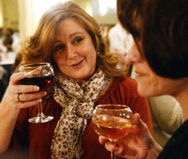 (from left) Jennifer Eilers and MaryAnn Bartek-Green talk and enjoy wine. They are attending Acoustic Uncorked; Another Doggone Wine Tasting to benefit The Center for Animal Health and Welfare held at Hotel Bethlehem on Sunday night.