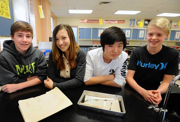 From left, Ryan Olsen, 13; Sofia Novacic, 13; Josh Choi, 13; and Greg Nelson, 13. Lime Kiln Middle School students construct a science project that will be used aboard the International Space Station. They are sending chryseobacterium aquaticum to the International Spoace Shtation to see what effect micro-gravity has on in it terms of growth.