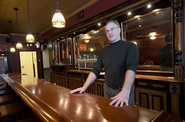 Dan Tanczos stands behind the bar in the saloon area of the Point Phillips Hotel in Moore Township. Tanczos has been fixing up the hotel where his dad proposed to his mom, and plans to open it as a restaurant soon.