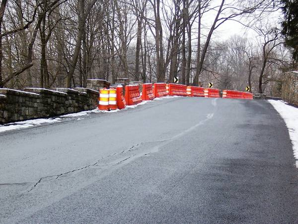 Barriers keep traffic on Park Road in Allentown's Little Lehigh Parkway from coming too close to a stone retaining wall in need of repairs.