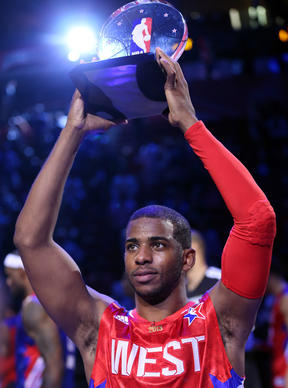 Chris Paul #3 of the Los Angeles Clippers and the Western Conference celebrates after winning MVP in the 2013 NBA All-Star game at the Toyota Center on February 17, 2013 in Houston, Texas.