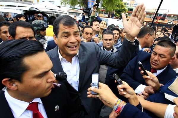 President Rafael Correa, center, arrives at a polling station in Quito, Ecuador.