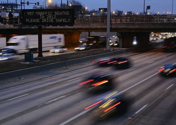A sign on the Dan Ryan Expressway warns motorists that nearly 1,000 people died in car crashes last year.