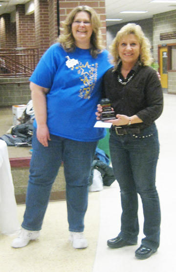 Jacki Prosper, left, awarded Cheryl Sayler of Sayler Construction second place in the soup category at the Central High School Show Choir Chili and Soup Cook-Off on Jan. 11.