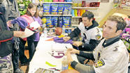 The season may be over and they may be former Ravens, but excitement for all things purple and black still drew a crowd on Saturday to the Giant Food store in Perry Hall for an event with former Baltimore Ravens Matt Stover and Kyle Richardson.