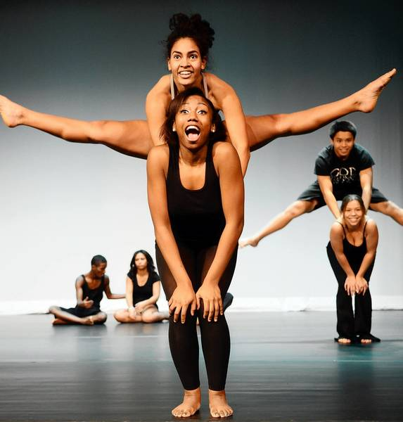 Reinys Beriguete does a jump on Da'Shane Hardy's back during a dance. The Allen High School Studio Dance Academy won an award from the city of Allentown.