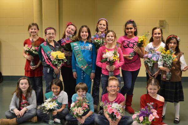 St. Mary of Gostyn Fourth Grade Girl Scouts pose with the flower arrangements they made for DuPage PADS.