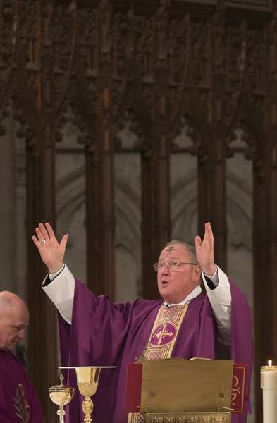 Cardinal Timothy Dolan, the Archbishop of New York, leads mass at Saint Patrick's Cathedral on Ash Wednesday in New York February 13, 2013.