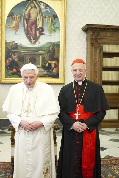 Pope Benedict XVI poses with Italian cardinal Angelo Bagnasco (R) during a meeting at the Vatican February 15, 2013. RETERS/Osservatore Romano