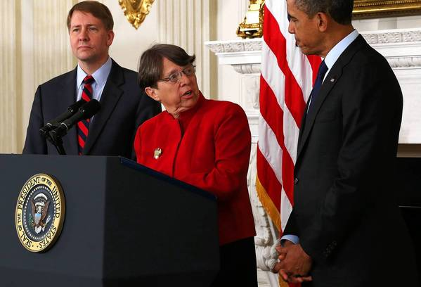 Former U.S. Attorney for the Southern District of New York Mary Jo White (center) speaks as President Barack Obama (right) and Director of the U.S. Consumer Financial Protection Bureau Richard Cordray look on during the announcement to nominate White to be the new chairman of Securities and Exchange Commission.