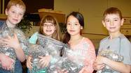 Students from Orland Park's High Point School are busy collecting pop tabs from soda, soup and other cans as a way to help sick children at Ronald McDonald House in Oak Lawn.