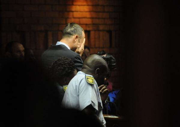 Oscar Pistorius weeps during a court appearance.