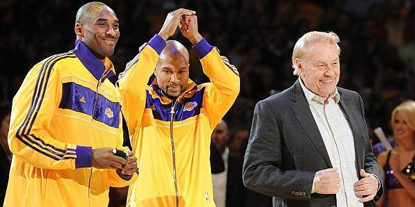 Jerry Buss takes center stage, along with Lakers guards Kobe Bryant and Derek Fisher, during the team's ring ceremony after claiming their 16th NBA championship the previous spring.
