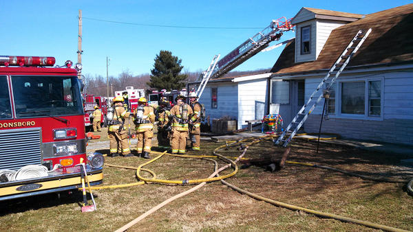 Firefighters from Boonsboro remained at the scene of a house fire on Locust Grove Road after bringing the blaze under control Monday.