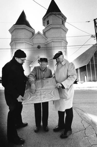 Rich Hayes, Carl Swich and Bob Suhs examine a piece of the tin ceiling of Old Sanctuary United Methodist Church on March 1, 1989. In an effort to save the landmark, the Village of Orland Park and church combined resources to renovate the building.