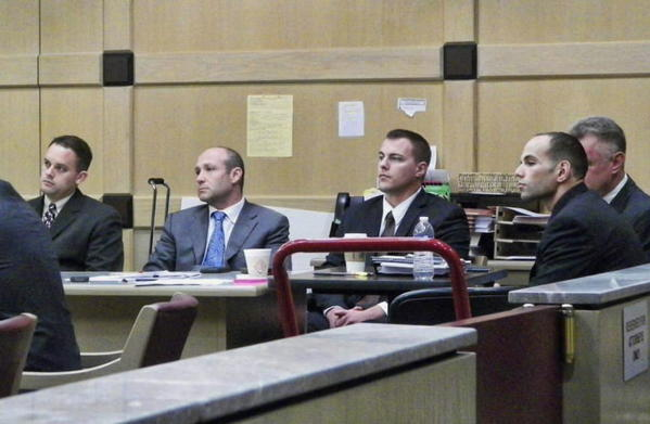From left, Fort Lauderdale Police Det. Sgt. Michael Florenco, defense lawyer Bradford Cohen, Det. Geoffrey Shaffer and Det. Matthew Moceri. The officers were tried in Feb. 2013 on charges of official misconduct and falsifying reports in connection with the pursuit and capture of Kenneth Post in 2010. After a hung jury and a mistrial, Broward Circuit Judge Cynthia Imperato acquitted the trio. The Broward State Attorney's Office is appealing her ruling.