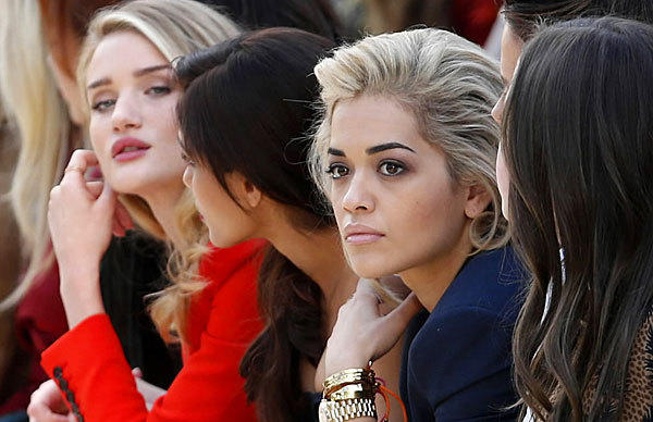 Model Rosie Huntington-Whiteley, far left, actress Freida Pinto and singer Rita Ora take in the Burberry Prorsum Winter 2013 collection at London Fashion Week on Feb. 18.