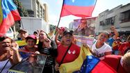 Hugo Chavez returns to Venezuela