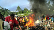 Two people face murder charges in Papua New Guinea after a woman was burned alive, a gruesome killing that drew global attention to sorcery slayings in the Pacific nation.