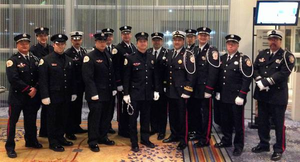 Des Plaines Fire Department honor guard members (left to right) Russ Olish, Matt Matzl, Shawn Quigel, Dave Macri, Robert Prieto, Kevin Jones, Jeff Gove, Mark Pawlyk, Ed Rogers, Chris Wozny, Eric Zack, Lukasz Szerlag, Scott Korona and Scott Pierson pose at the new member induction dinner at the AFFI's 21st Annual Honor Guard Convention in Schaumburg.