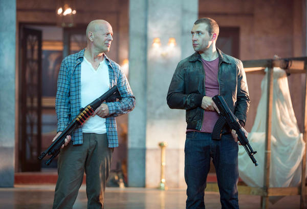"This film image released by 20th Century Fox shows Bruce Willis as John McClane, left, and Jai Courtney as his son Jack in a scene from ""A Good Day to Die Hard."""