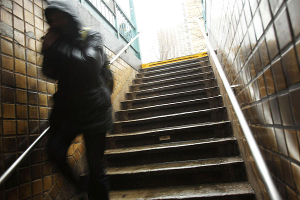 A man enters a subway station in New York. At the Columbus Circle station Sunday, a man who fell onto the tracks was rescued by three men moments before a train pulled in.