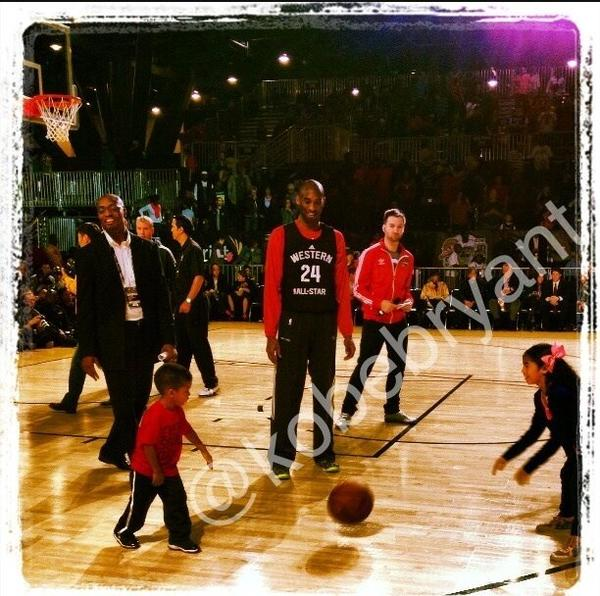 Kobe Bryant's daughter, right, plays with Chris Paul's son during NBA All-Star weekend in Houston.
