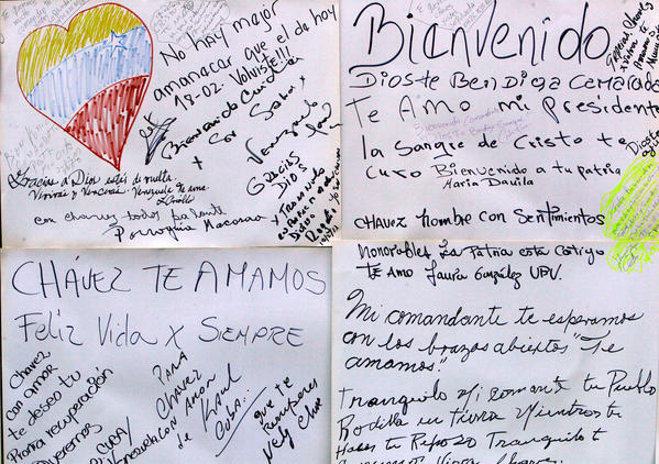 Welcome home and get-well messages for Venezuelan President Hugo Chavez adorn a wall near Bolivar Square in Caracas, the capital, on Monday.